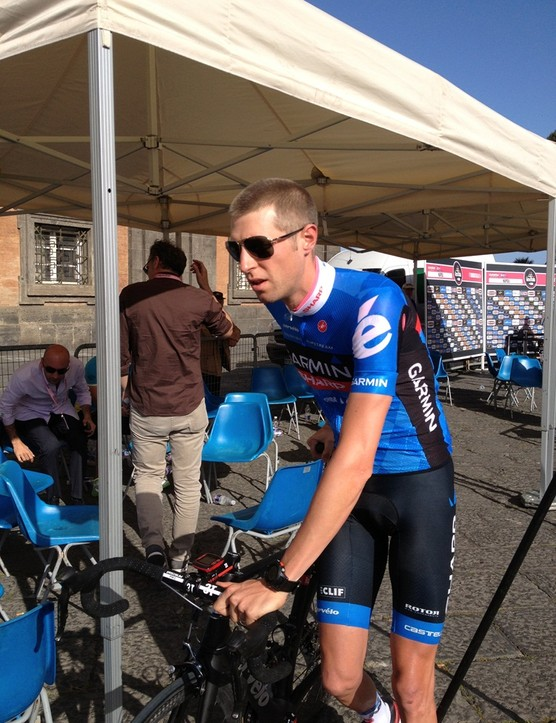 Media duties done for now, defending maglia rosa Ryder Hesjedal makes his way to the presentation area