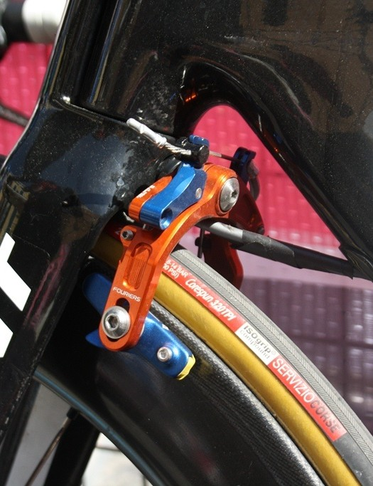 Blue and orange brakes sheltered behind the fork hark back to the Blanco team's origin as Rabobank last year