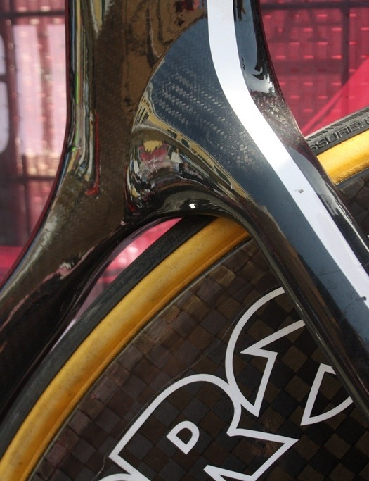 The seat tube has a subtle curve away from the wheel where it joins the seatstays