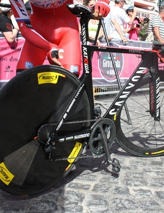 It's one year since the Canyon Speedmax CF Evo was launched at the Giro. Here, a Katusha rider inspects his rear tyre for shards just ahead of the start