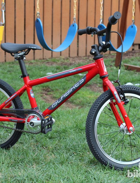 The Islabikes CNOC 16 is a lightweight aluminum bike with a coaster brake and a reach-adjust hand brake