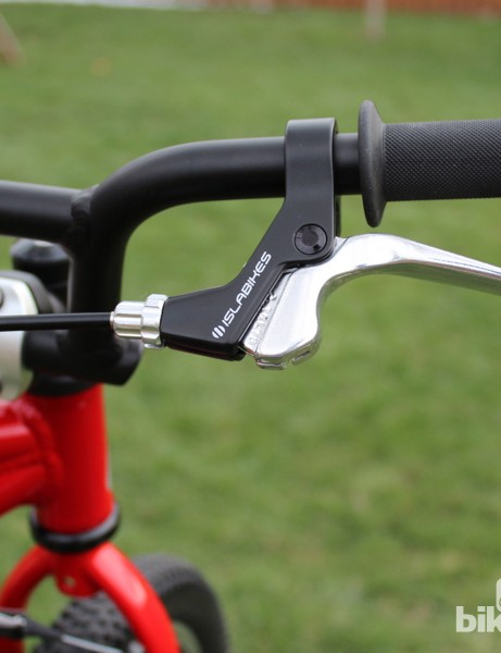A small alloy brake lever features reach adjust to fit small hands