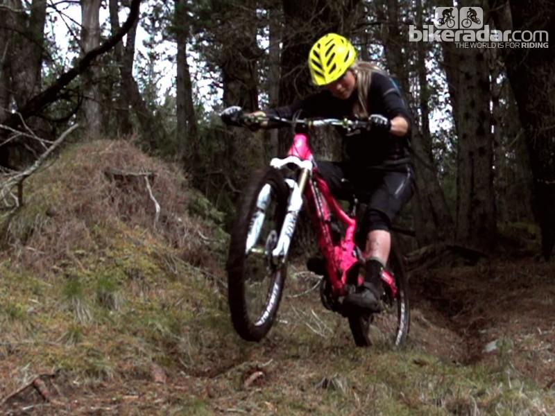 Hannah Barnes blasts her Orange five trail bike around her local trails in Fort William, Scotland