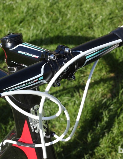 The bar and stem are made by Bianchi's own-brand Reparto Corse, and there are flecks of celeste green elsewhere on the bike too