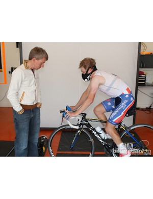 Timmy Duggan and his coach Jon Tarkington are experimenting with reduced-oxygen intervals, limiting air intake with a mask in an attempt to create a physiological response