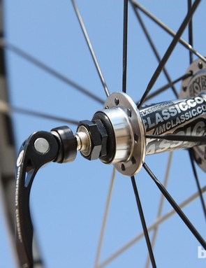 A pair of aluminum nuts allows for adjustable bearing preload on the rear hub. Proper adjustment is critical, however, as the radial cartridge bearings aren't very tolerant of side loading
