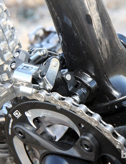 The front derailleur attaches directly to the swingarm