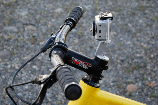 The GoPro camera mount offers a clear view of the trail just above the bar