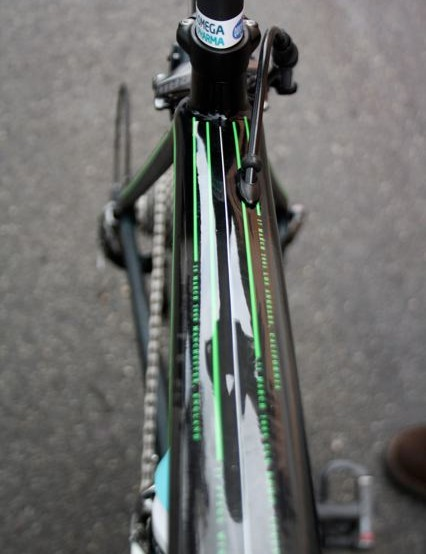 The top tube is decorated with thin green lines and dates that recall Cavendish's major career wins