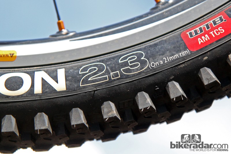 Tire width is dependent on rim width. Rim width should be listed, too, specifying how a tire maker determines a given width