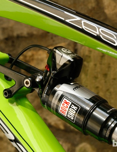The small servo motor adjusts low-speed compression damping on the RockShox Monarch RT3 E.I shock as you ride