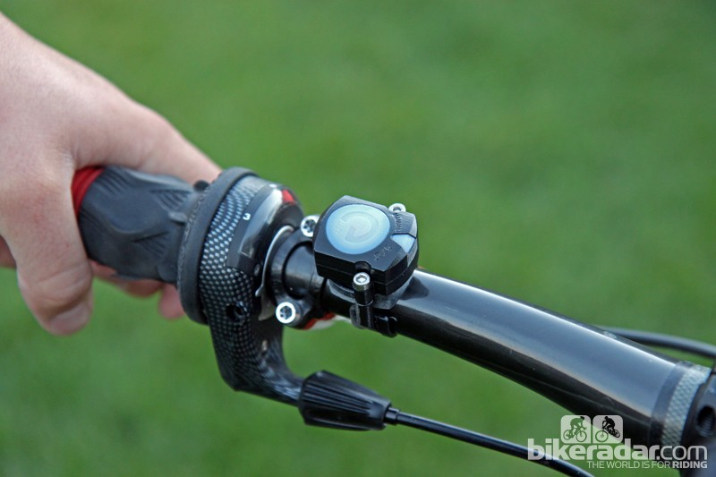 The ANT+-enabled wireless remote is used to manually switch the Magura eLECT damper from open to lockout modes. Once finalized, it can also replace the standard backplate on Magura brake levers for a very tidy setup
