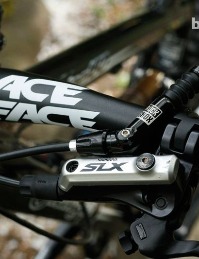 The RaceFace bar, Shimano SLX shifter and Reverb remote make a good match