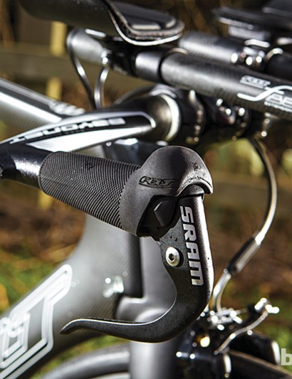 The brake levers are sharp but the rubber base bar grips are great in the wet