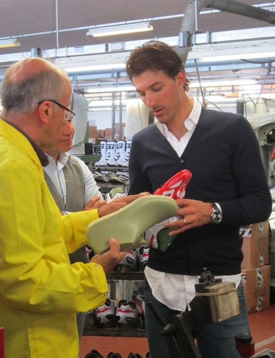 Three-time Paris-Roubaix winner Fabian Cancellara is taken through the details of his customised Carbon G.Chrono shoes