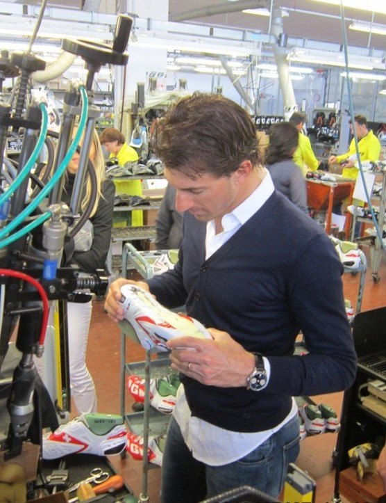 Cancellara examines the workmanship of the genuine leather shoes