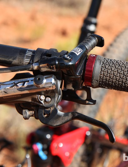 It's a tight fit with the Shimano Deore XT brake levers and RockShox Reverb dropper post remote