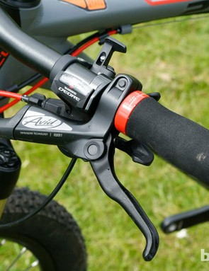 Shimano Deore shifters in residence with Avid's Elixir 1 hydraulic brakes. Hard foam grips might not be for everyone