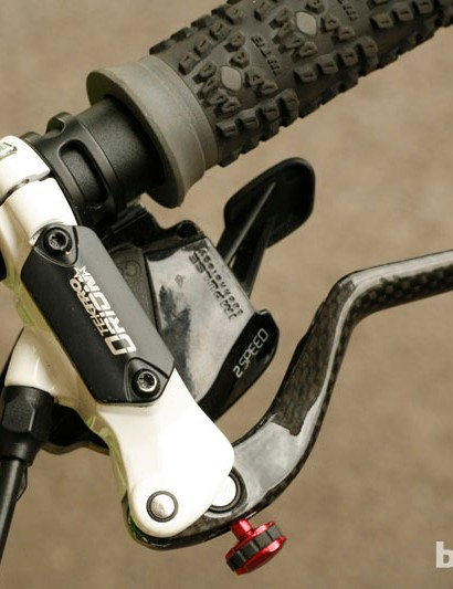 A SRAM X9 shifter sits under the Tektro Orion bake setup