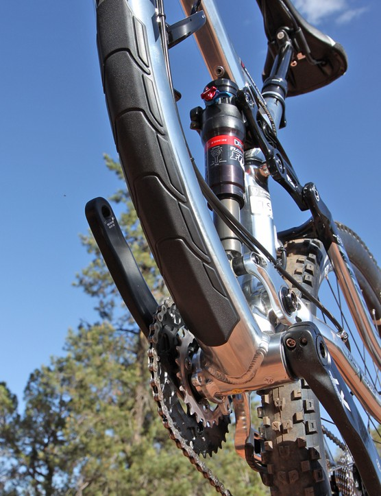 A beefy molded plastic guard protects the bottom of the down tube