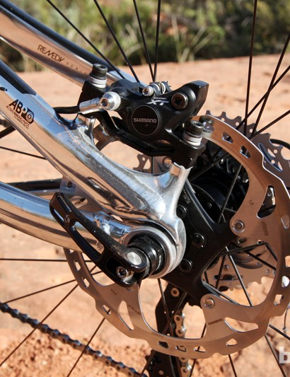 The rear brake bolts onto post-mount tabs