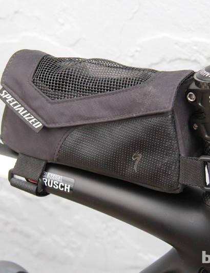 Many riders use a 'Bento box,' a small feed bag mounted to the handlebar or top tube