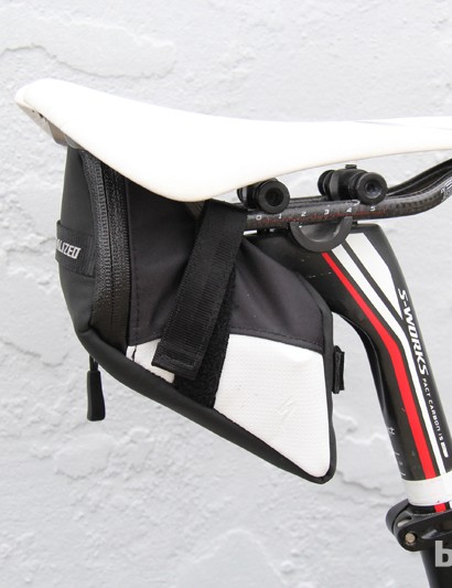 A small saddle bag just large enough for a couple of tubes and a multi-tool
