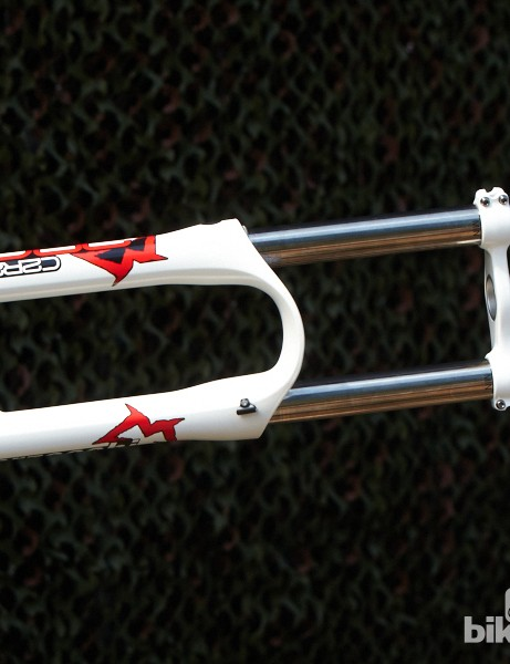 Marzocchi was showing its new 380 C2R2 fork. Adjustments include high- and low-speed compression and high- and low-speed rebound through their new semi-sealed damper cartridge. The hollow crown and internally and externally tapered stanchions help drop this coil-sprung fork's weight to 2795g. Marzocchi claims its stiffer than last year's thanks in part to the new fork arch, which is wide and flat. This also means there's masses of tyre clearance which enable the 380 to be used with 26in or 650b (27.5in) wheels.