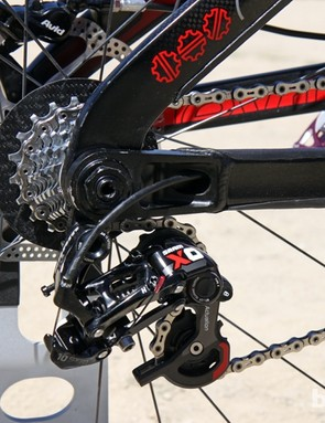The rear derailleur cable is routed through the chain stay
