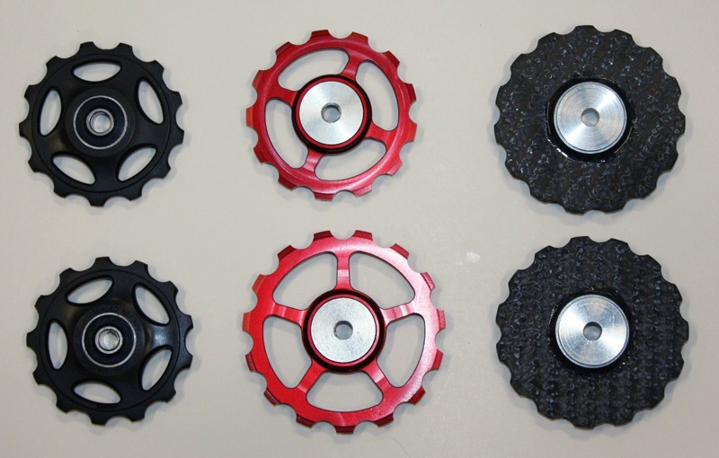 Among the pulleys tested were 13-tooth Shimano Dura-Ace 7700 (left), Berner's 13/15-tooth set (middle), and a pair of 15-tooth ones from RALTech (right)