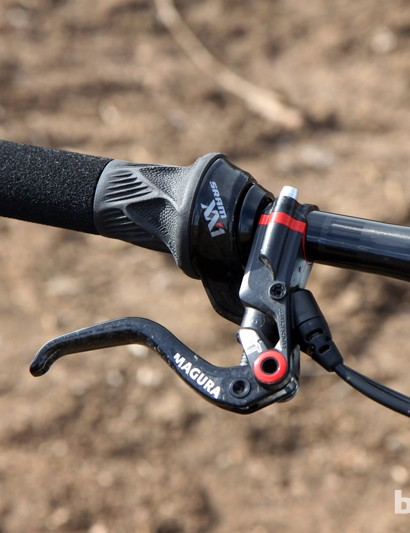 Magura's 'Carbotecture' molded carbon fiber brake levers are paired to a single SRAM XX1 Grip Shift shifter