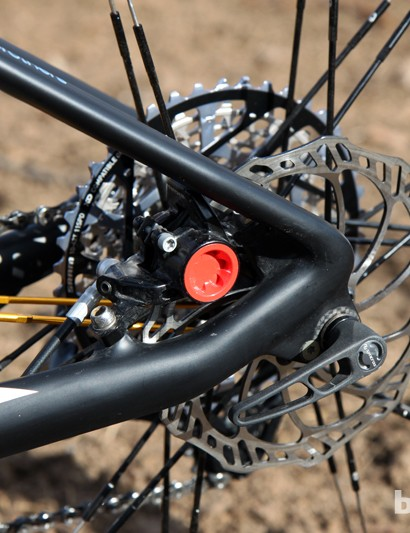 The Magura MT8 rear brake caliper is tucked away between the stays