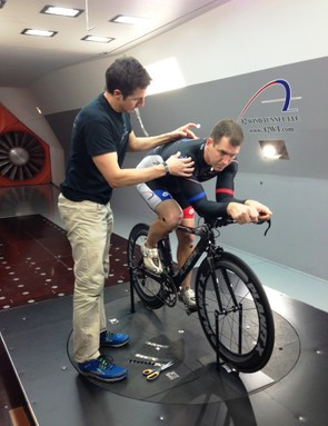 A2 manager David Salazar affixes measurement points on a rider inside the tunnel