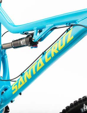 The shift cables are routed along the top of the downtube, while the rear brake line is tucked underneath the top tube