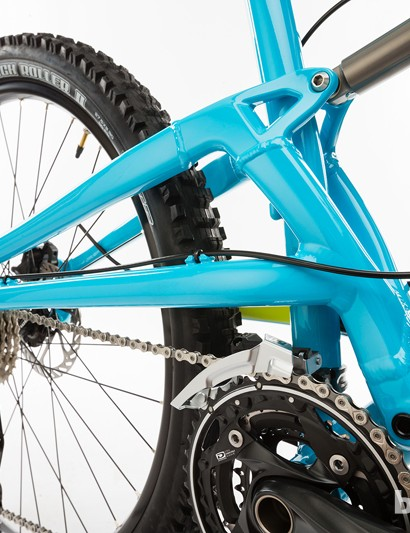The pivot is mounted to the downtube, just in front of the cranks
