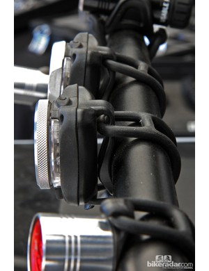 The Lezyne Zecto (background) and Zecto Pro (foreground) lights both feature a clever attachment method that either clips directly on to clothing or straps on to various components