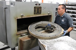 Weighing about 65lb, the clamped mold is inserted into an oven for curing