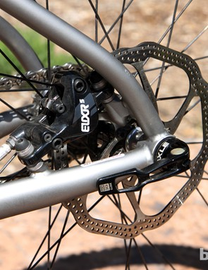 Post mount rear brake caliper tabs are tucked away inside the rear triangle on the new Niner ROS 9