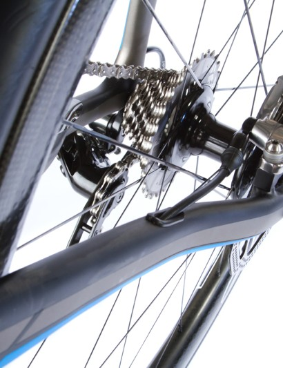 Since the hydraulic brake routing is done through the down tube, so too is the mechanical routing, and therefore the rear rim brake mounts are under the chainstays
