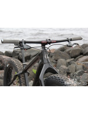 Upfront there's a massive tapered head tube and stout carbon fork