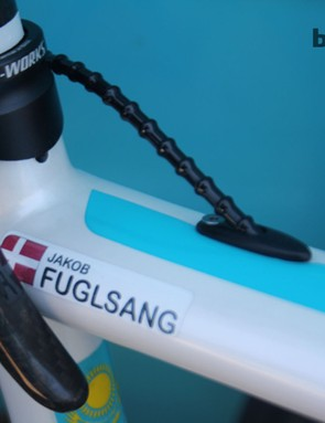 Jakob Fuglsang's Specialized Tarmac SL4 stands out from the rest of the Astana squad's bikes because he's running a fully mechanical Campagnolo Record 11 groupset. Transmission is enhanced with use of Alligator I-Link cables