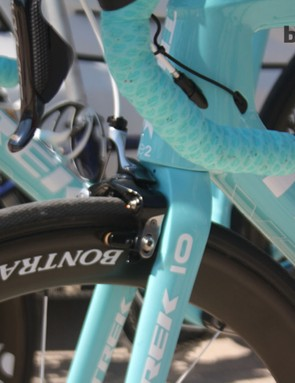 The Trek's tapered E2 head tube and fork configuration is prominent in the Project One generated colour scheme