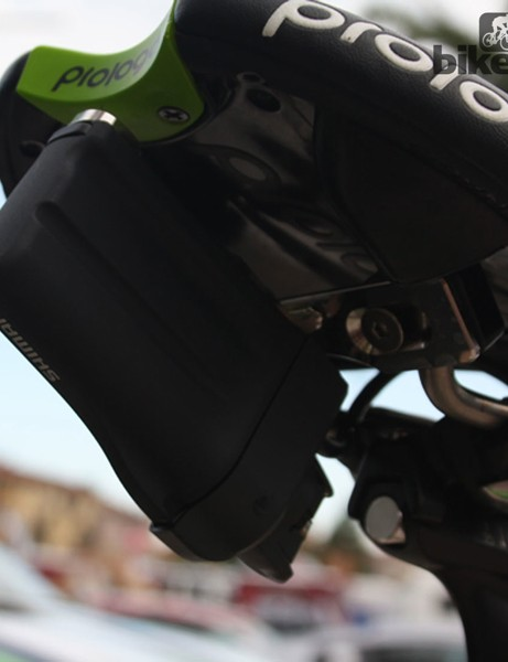 The first generation Dura-Ace Di2 battery is mounted on a plate clamped to the seat rails