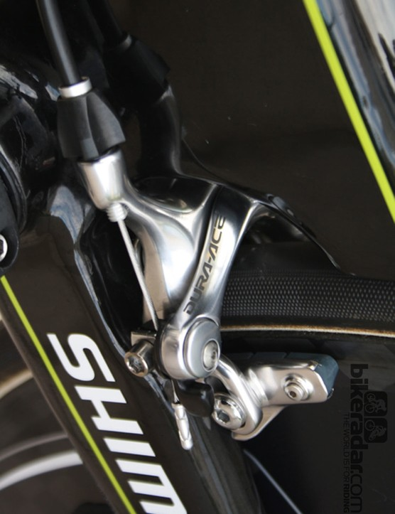 A conventional Dura-Ace brake is mounted horizontally and anchored in the high volume of carbon around the bottom bracket
