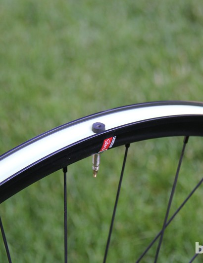 The wheels come with tubeless tape installed. Valve stems and sealant are also included