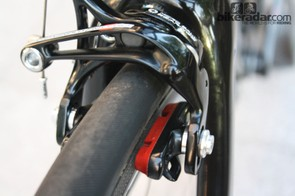 Campagnolo Record 11 Skeleton brakes with carbon-specific brake pads provide the stopping power
