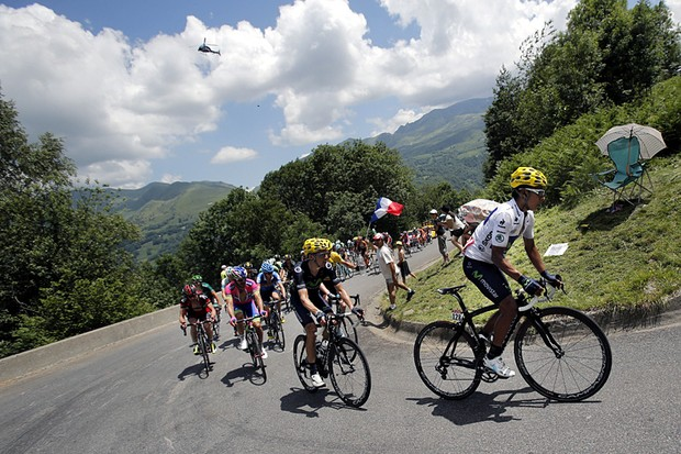 Nairo Alexander Quintana of Colombia, wearing the best young rider's white jersey, and Roman Kreuziger of the Czech Republic, in second position climb Hourquette d'Ancizan pass