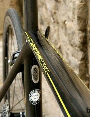 The top tube tapers in where it meets the seat tube junction, and is flat on top