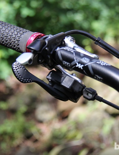 On the left side of Sternberg's handlebar there is an XTR front brake lever, most of an XTR front shift lever and the CTD remote for his Fox Float X shock; the XTR shift lever has been repurposed to function as the remote for his Fox DOSS seatpost
