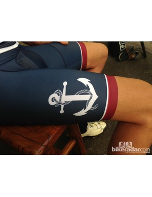 The same logo is used on the right leg of the bib shorts